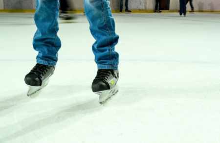 Men`s legs in ice skates