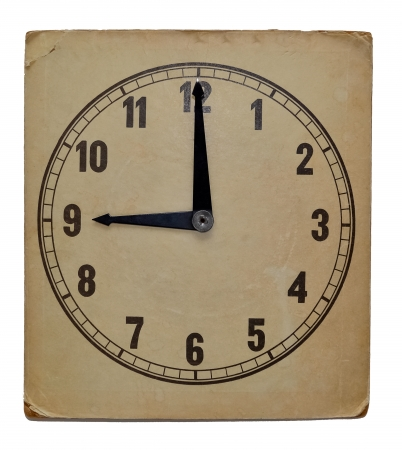 Old vintage wall clock isolated on white background. Showing 9 pm