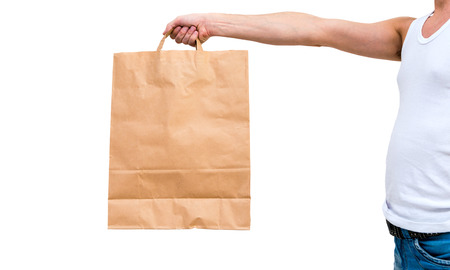 Man in undershirt holding a paper bag isolated on white background photo