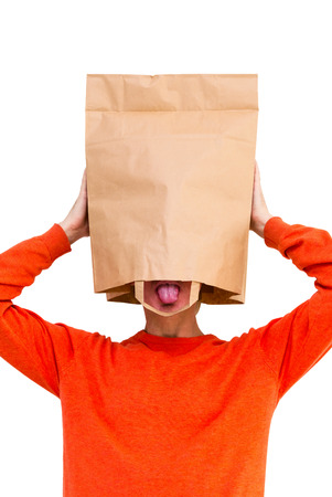 Man in paper bag on head with protruding tongue, isolated on white background. photo
