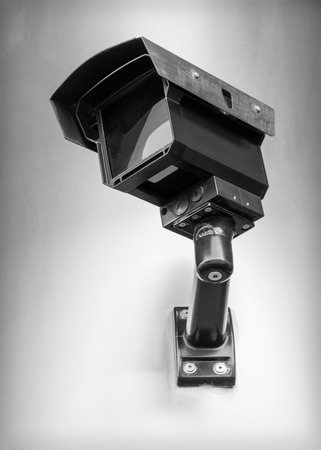 Security camera on the wall in black and white colors photo