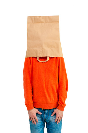 Man in paper bag on head and shoulders  isolated on white background. photo