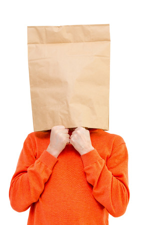 pull over: Man in paper bag on head, isolated on white background. Stock Photo