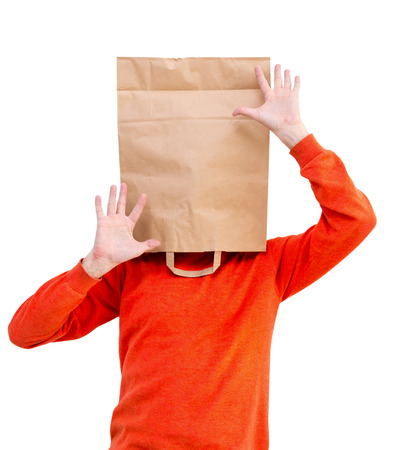 Man in paper bag on head, isolated on white background. Stock Photo