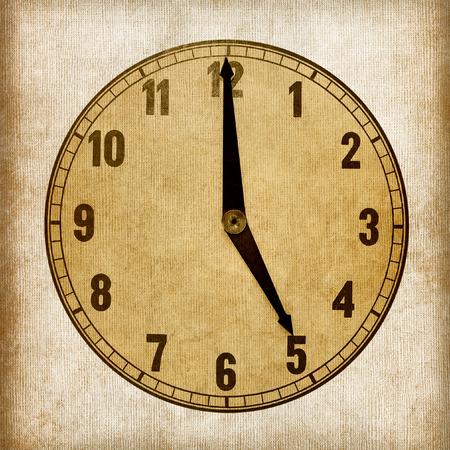 oclock: Textured old paper clock face showing 5 oclock