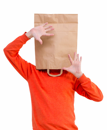Man in paper bag on head, isolated on white background. photo