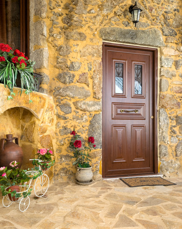 Charming entrance of courtyard of old mediterranean village Spil photo
