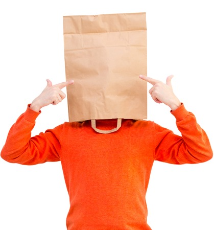 Man  in paper bag on head showing  with forefingers isolated on white background. Stock Photo
