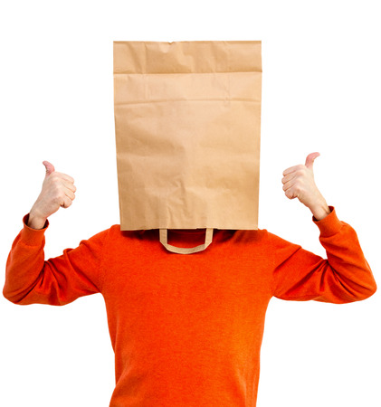Man in bright clothes with a paper bag on head, isolated Stock Photo