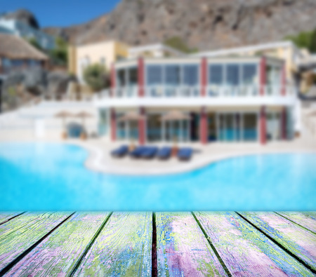 wood deck in front of luxury hotel with pool Stock Photo