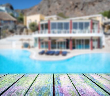 wood deck in front of luxury hotel with pool Zdjęcie Seryjne