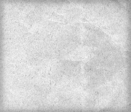 white textured paper: Old grey paper texture or background with vignetting. Closeup.