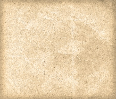 yellowed: Old beige paper texture or background. Closeup.