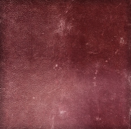 bookcover: Dark red old grunge vintage scratched leather texture for background with copyspace for text. Closeup Stock Photo