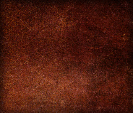 bookcover: Dark brown old grunge vintage scratched leather canvas texture for background with copyspace for text. Closeup Stock Photo