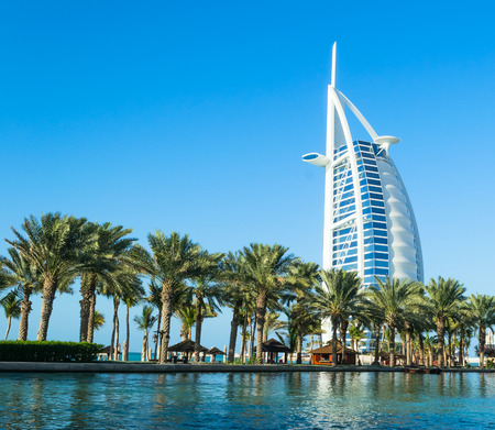 known: DUBAI, UAE - December, 10, 2013: A general view of the worlds first seven stars luxury hotel Burj Al Arab Tower of the Arabs, also known as Arab Sail Editorial