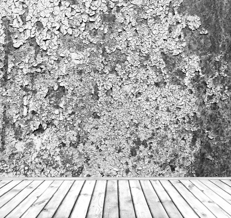 Background with an empty grey dirty wall with wooden plank floor below with copy space for your text photo