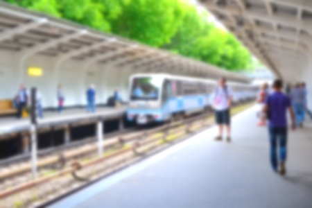 subway platform: Blurred people on subway platform waiting for a train