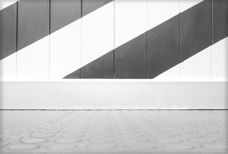 sidelong: Background with wry empty wall colored diagonally and tile floor with copy space for your text Stock Photo