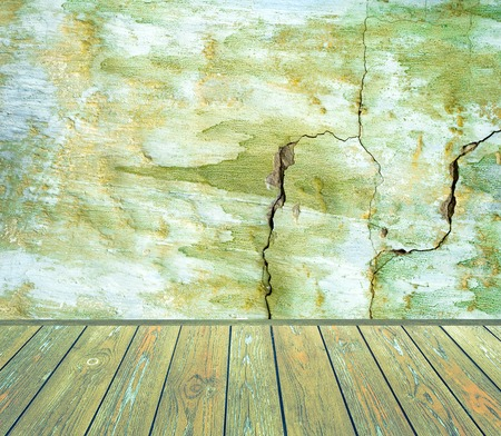 damaged cement: Room old interior: green grunge damaged cement wall with wooden floor