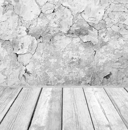 damaged cement: Room interior: grey damaged cement wall with wooden floor Stock Photo
