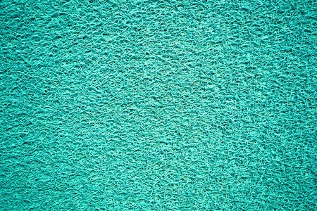 floor texture: Background and texture of artificial green grass pattern