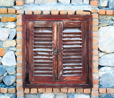 kayakoy: Old wooden mediterranean window shutters closed in the stone house