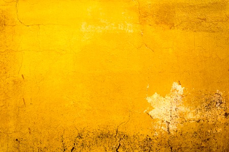 Yellow painted old dirty concrete wall texture or background