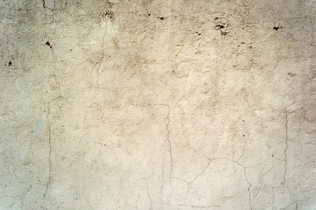 Cracked concrete painted wall background or texture. Close-up