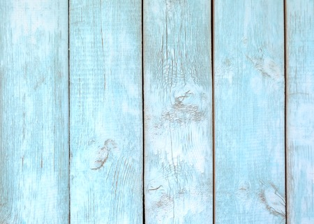 Old painted light blue wood fence - texture or background