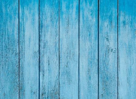Oud blauw geschilderd houten hek - textuur of achtergrond