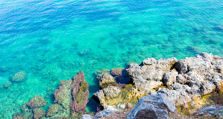 Underwater sea background. Blue transparent turquoise water with stones. Tropical sea water background.