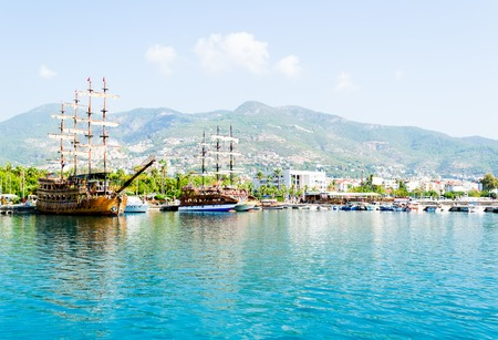 Beautiful wooden ships sailing in the Mediterranean sea against the mountains of Turkey