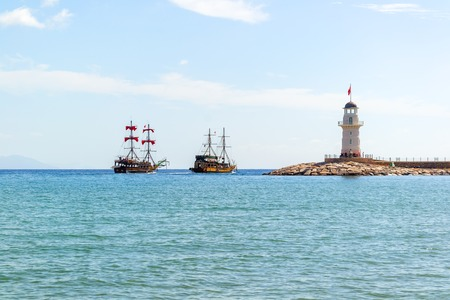 sailing boats: Lighthouse and sail ships in the Mediterranean sea, Alanya, Turkey