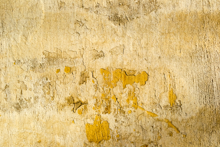 unkept: Yellow old dirty concrete cracked wall texture or background Stock Photo