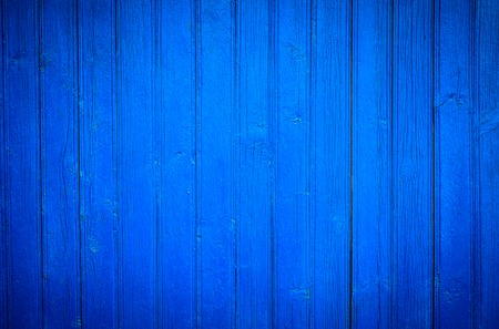 painted wood: Blue painted natural wood background texture. Closeup