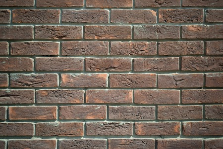 Background of old grunge brick wall texture with delicate vignetting. Stock Photo