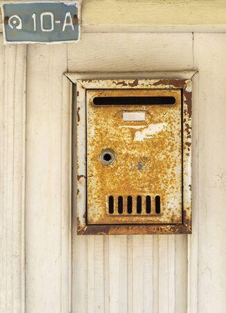 Metal rusty mail box on the door