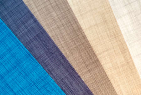 Various natural fabric samples background.