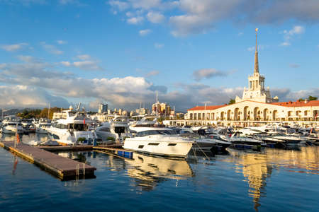 Marine Station with ships and yachts on the shore of the Black Sea in Sochi