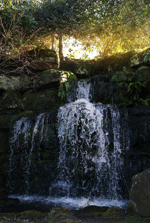 13th century: waterfall 250 acre park  13th century Tudor manor Stock Photo