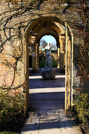 HEVER CASTLE AND GARDENS, KENT, UK - MARCH 10, 2014  park sculpture in 13th century Tudor manor photo