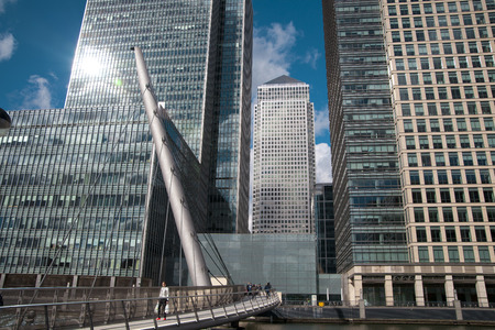 towed: LONDON, UK - CANARY WHARF,  MARCH 22, 2014  View on Canada towed from the bridge, glass reflection modern buildings