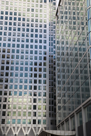 world's: LONDON, UK - CANARY WHARF, MARCH 22, 2014  Modern glass buildings of the biggest business district in London  Headquarters for main world s banks, insurance, media companies etc