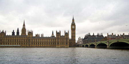 british touring car: Big Ben and houses of Parliament on the river Thames, London UK