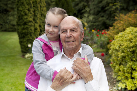 old man happy: Granddad with Granddaughter in the garden