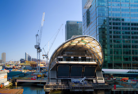 LONDON, UK - APRIL 24, 2014  Building site with cranes Canary Wharf aria, one of the leading centres of global finance, headquarters for leading banks, insurance, stock exchange, media businesses  Stock Photo - 28195815