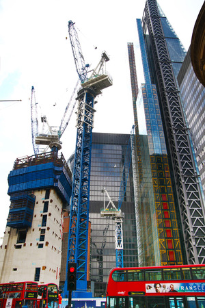 LONDON, UK - APRIL 24, 2014  Building site with cranes in the City of London one of the leading centres of global finance   Stock Photo - 28196006