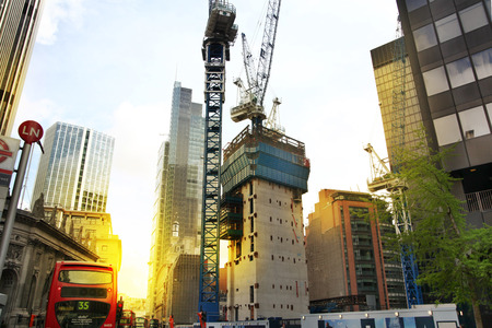 LONDON, UK - APRIL 24, 2014  Building site with cranes in the City of London one of the leading centres of global finance   Stock Photo - 28196029