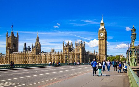 LONDON, UK - MAY 14, 2014  Big Ben, Houses of parliament and Westminster bridge on river Thames